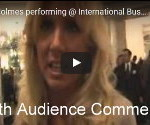 Grant sings at an international business conference